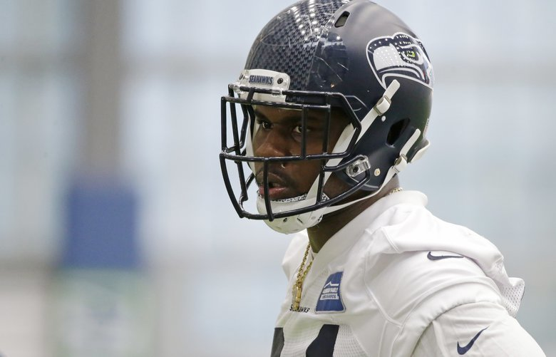Defensive tackle Malik McDowell, the Seattle Seahawks' top draft pick, watches a drill during NFL football rookie minicamp, Friday, May 12, 2017, in Seattle. (AP Photo/Ted S. Warren)