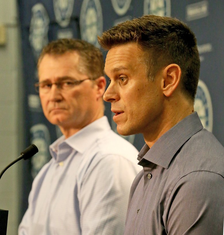 Seattle Mariners manager Scott Servais, left and Mariners General Manager Jerry Dipoto address the media at a news conference at Safeco Field on Tuesday. (Greg Gilbert/The Seattle Times)