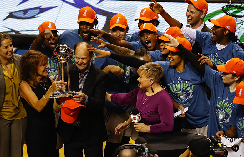 Minnesota Lynx owner Glen Taylor accepts the championship trophy after an 85-76 win against the Los Angeles Sparks in Game 5 of the WNBA Finals on Wednesday at Williams Arena in Minneapolis. (Renee Jones Schneider/TNS)
