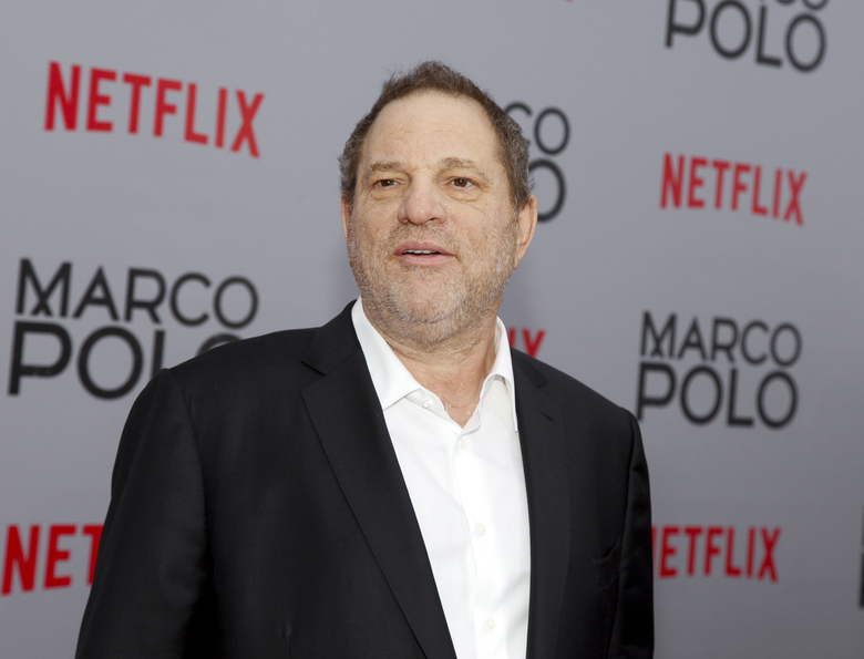 "FILE – In this Dec. 2, 2014, Harvey Weinstein attends the season premiere of the Netflix series ""Marco Polo"" in New York. Weinstein faces multiple allegations of sexual abuse and harassment from some of the biggest names in Hollywood. (Photo by Andy Kropa/Invision/AP, File)"
