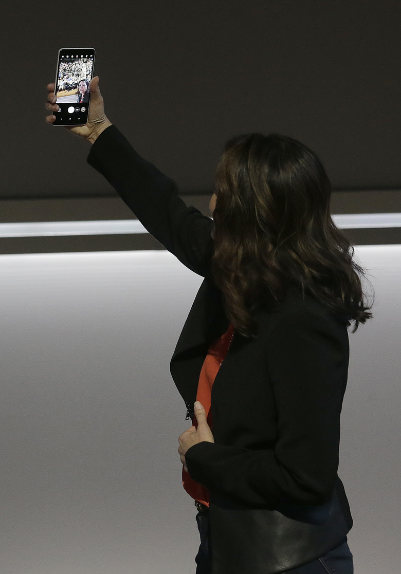 Google's Sabrina Ellis holds up a Google Pixel 2 XL phone at a Google event at the SFJAZZ Center in San Francisco, Wednesday, Oct. 4, 2017. (AP Photo/Jeff Chiu)