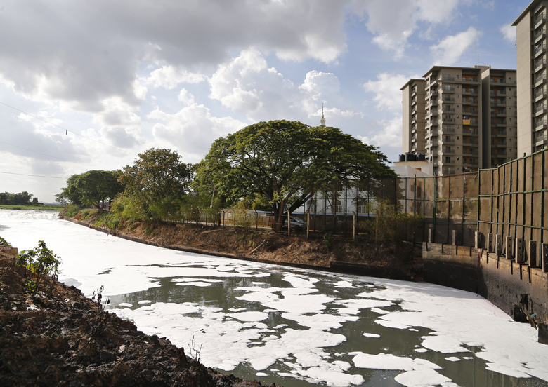 FILE – In this June 5, 2017, file photo, toxic froth from industrial pollution floats on Bellundur Lake on World Environment Day, in Bangalore, India. Environmental pollution – from filthy air to contaminated water – is killing more people every year than all war and violence in the world.  (AP Photo/Aijaz Rahi, File)