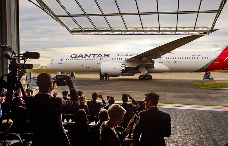 A giant door opens at the Future of Flight Aviation Center in Everett to reveal Qantas airlines first 787-9 Dreamliner  late Monday afternoon October 16, 2017.