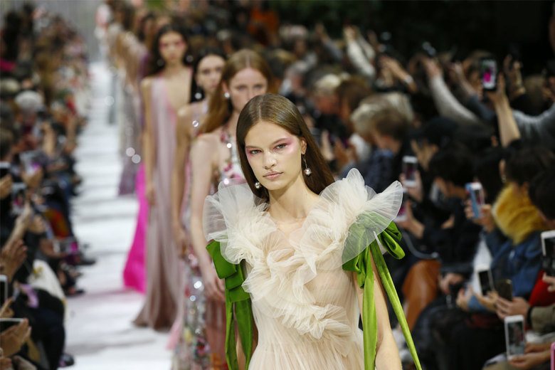 Models wear creations for Valentino Spring/Summer 2018 ready-to-wear fashion collection presented in Paris, Sunday, Oct. 1, 2017. (AP Photo/Francois Mori)