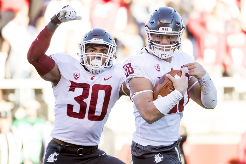 Washington State defensive lineman Hercules Mata'afa celebrates with Washington State defensive lineman Nnamdi Oguayo after recovering a fumble by Utah quarterback Tyler Huntley. (Bettina Hansen / The Seattle Times)