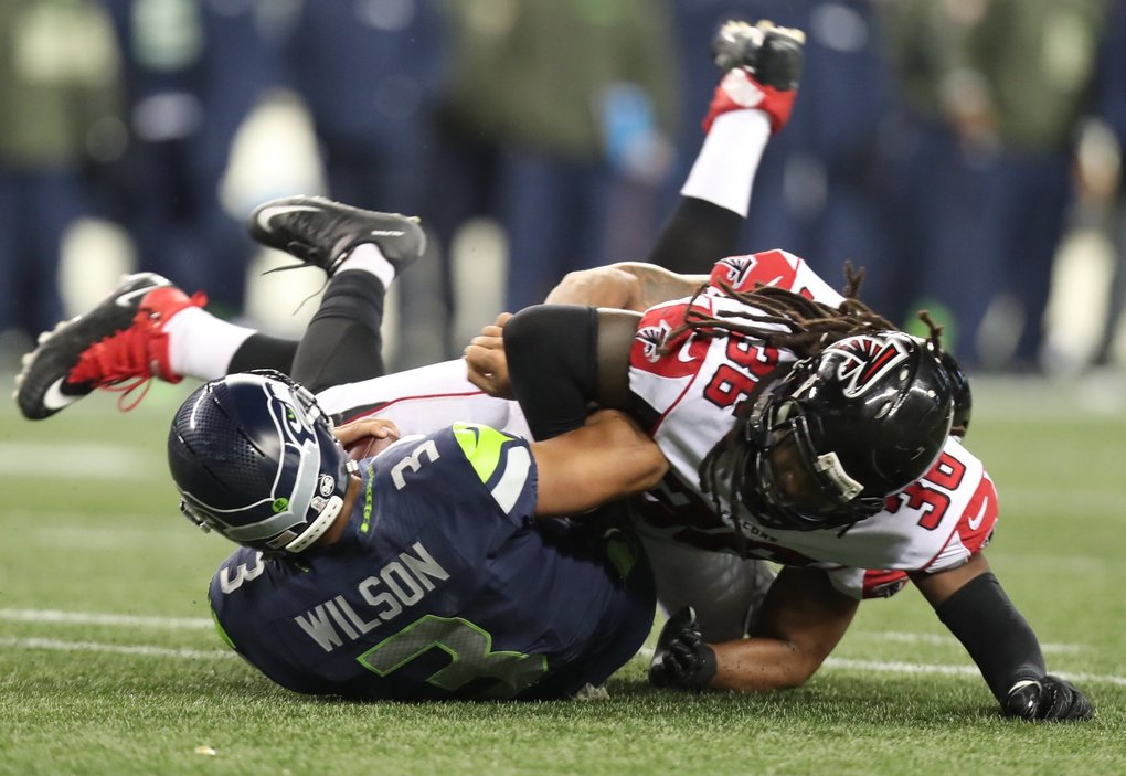 Seahawks quarterback Russell Wilson is sacked by Kemal Ishmael for a loss of 12 yards in the third quarter.  (Bettina Hansen / The Seattle Times)