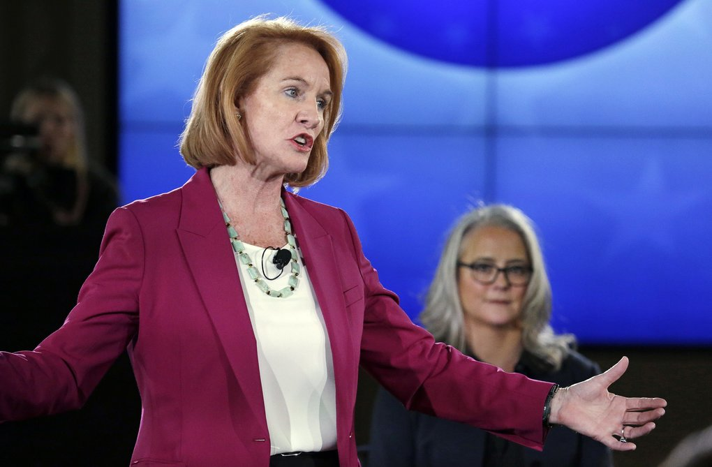 Seattle mayoral candidates Jenny Durkan, left, and Cary Moon debate last month in Seattle. (Elaine Thompson/AP)