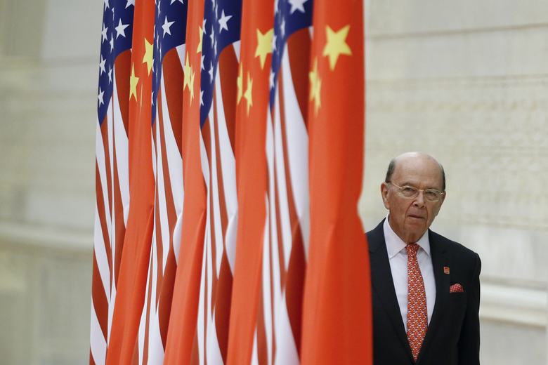 U.S. Commerce Secretary Wilbur Ross arrives at a state dinner at the Great Hall of the People in Beijing, China, Thursday, Nov. 9, 2017. (Thomas Peter/Pool Photo via AP)