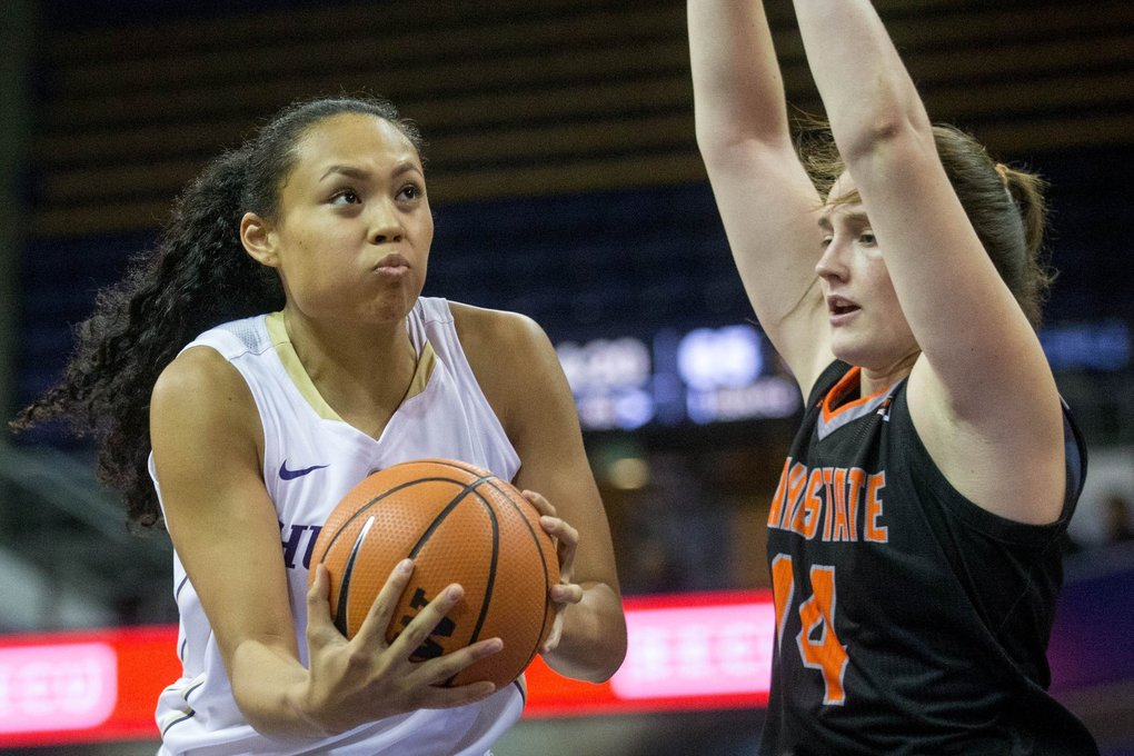 Washington Huskies forward Mai-Loni Henson shoots against Idaho State Bengals guard Estefania Ors ( during a game at Alaska Airlines Arena in Seattle on Sunday. (Courtney Pedroza / The Seattle Times)