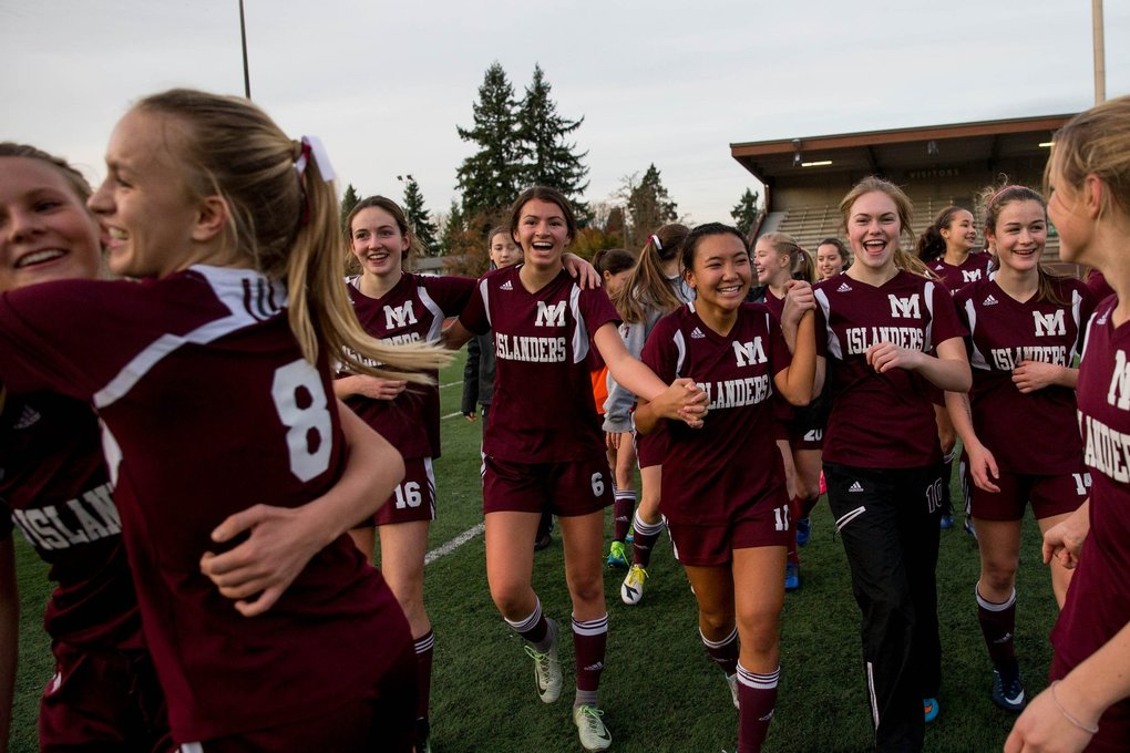 Mercer Island celebrates after winning the 3-A championship game against Stadium 4-1 at Sparks Stadium in Puyallup, on Saturday. (Courtney Pedroza / The Seattle Times)