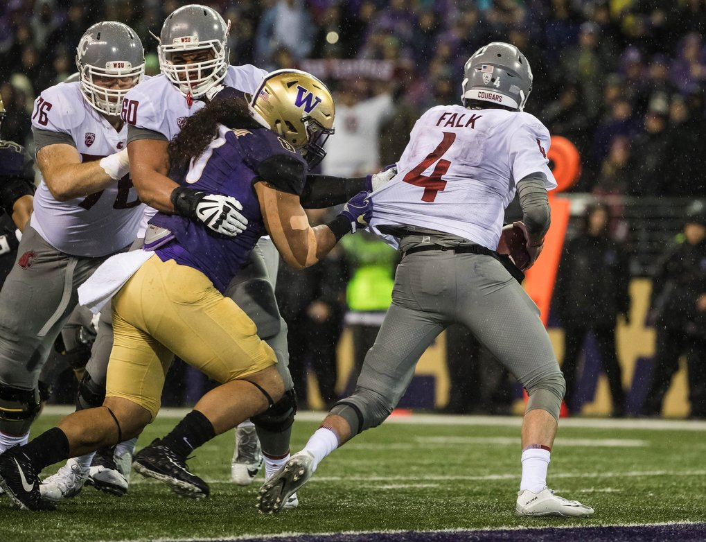 Benning Potoa'e gets to Cougar quarterback Luke Falk on the goal line and sacks him. Forward progress was given to the 1 avoiding the safety.  (Dean Rutz / The Seattle Times)