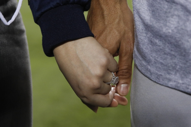 Daniella Rodriguez and her engagement ring hold hands with the Astros' Carlos Correa after he proposed after Game 7.  (Jae C. Hong/AP)