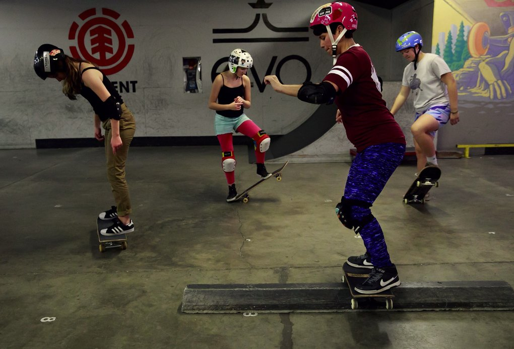 Violet Angell, 14, from left, Cora Borden, 13, Sylvia Raskin, 32, and Maddy Brown, 21, practice during the Skate Like A Girl's Ladies* Night at the All Together Skatepark in Fremont recently. (Erika Schultz/The Seattle Times)