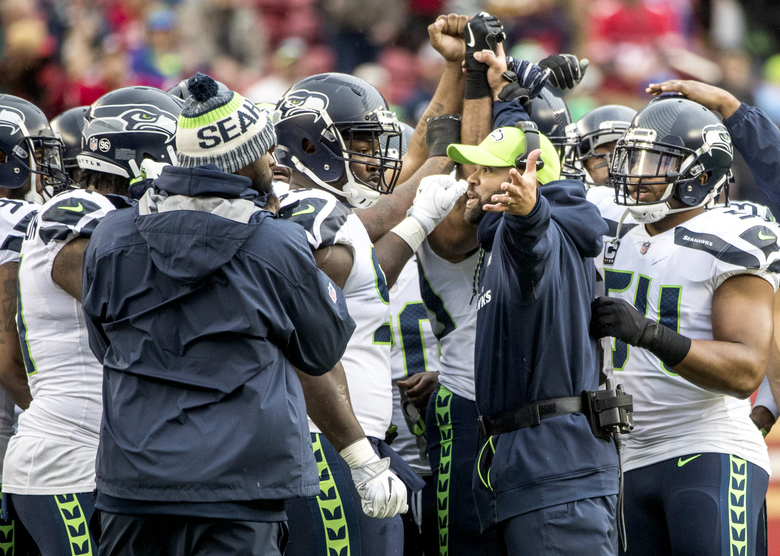 Seahawks defensive coordinator Kris Richard tells his squad to get out there after Russell Wilson's first pass is picked off by 49ers strong safety Eric Reid as the Seattle Seahawks take on the San Francisco 49ers at Levi's Stadium in Santa Clara, California Sunday November 26, 2017. 204310 — 204310 (Bettina Hansen/The Seattle Times)