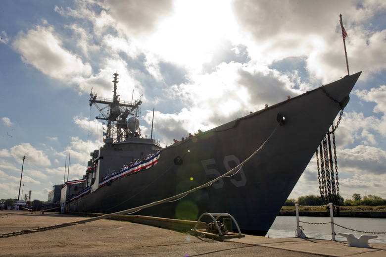 In this Sept. 18, 2015, photo released by the U.S. Navy, the guided-missile frigate USS Kauffman is honored at a decommissioning ceremony at Naval Station Norfolk in Norfolk, Va. The Kauffman was the last operational Oliver Hazard Perry-class frigate to be retired. Shipbuilder Bath Iron Works in Bath, Maine, said in November 2017 that it is offering a new design concept in response to a Navy request for up to 20 new frigates. (Shane A. Jackson/U.S. Navy via AP)