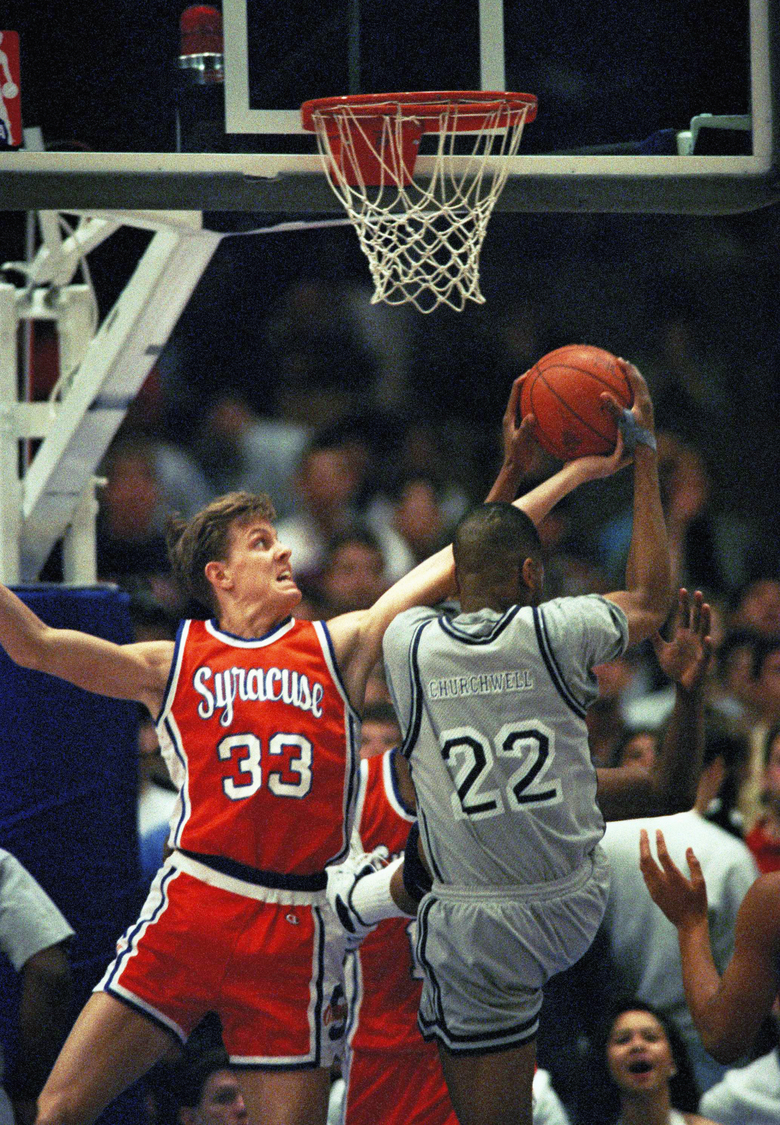 Mike Hopkins, left, went to Syracuse from his home in California and eventually became a two-year starter and team captain. (Mark Lennihan/ASSOCIATED PRESS)