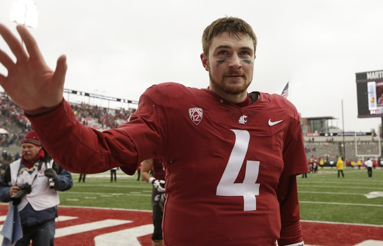 Washington State quarterback Luke Falk (4) waves at fans after an NCAA college football game against Stanford in Pullman, Wash., Saturday, Nov. 4, 2017. (AP Photo/Young Kwak) OTK OTK