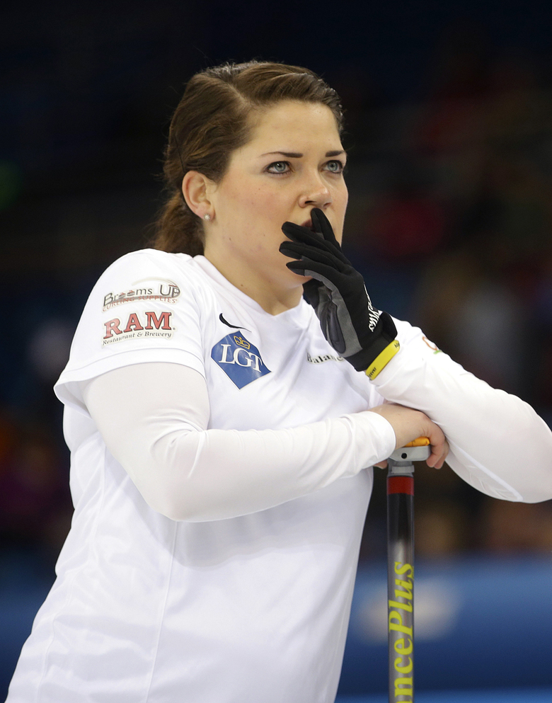 FILE – In this March 23, 2017, file photo, United States' Becca Hamilton watches the action during a match against Switzerland at the Women's World Curling Championship in Beijing. When action in his game at the U.S. Olympic curling trials is in a lull, Matt Hamilton admits he takes a peek at the adjacent sheet of ice to see how his sister Becca is faring. Matt and Becca Hamilton of McFarland, Wisconsin, are competing this week at the U.S. Olympic curling trials in Omaha, Nebraska, for spots on the men's and women's teams that will compete in the Winter Olympics. (AP Photo/Mark Schiefelbein, File)