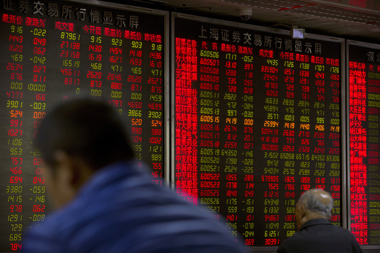 Chinese investors monitor stock prices at a brokerage house in Beijing, Tuesday, Nov. 7, 2017. Asian stocks surged Tuesday after Wall Street posted modest gains on deal reports and turmoil in Saudi Arabia sent crude prices soaring. (AP Photo/Mark Schiefelbein)