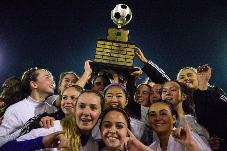 Issaquah celebrates after winning the 4A championship game 2-1 against Central Valley at Sparks Stadium in Puyallup, on Saturday. (Courtney Pedroza/The Seattle Times)