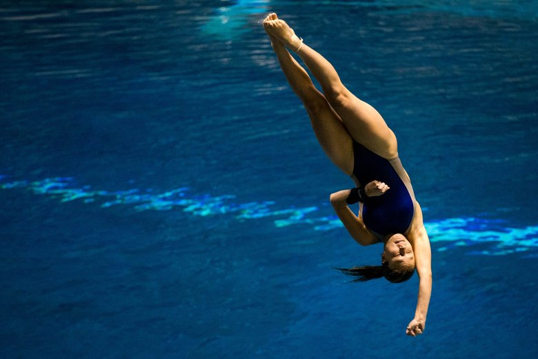 Helene Synnott completes a 2.3 difficulty dive at the Class 3A state swimming and diving championships on Saturday. (Courtney Pedroza/The Seattle Times)
