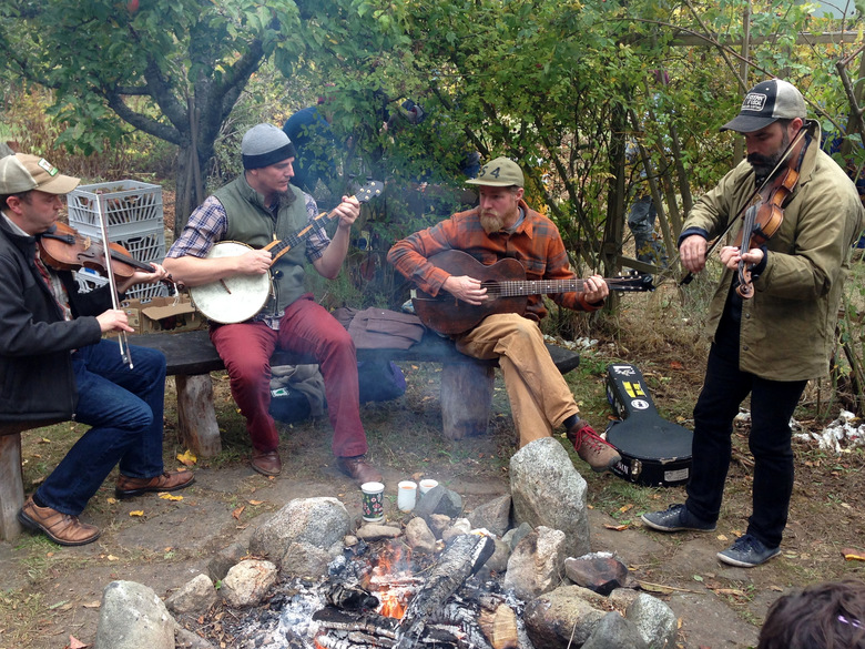 In an orchard at Fruit City Farms on Lopez Island, musicians entertain around a bonfire during a recent farm tour. (Brian J. Cantwell / The Seattle Times)