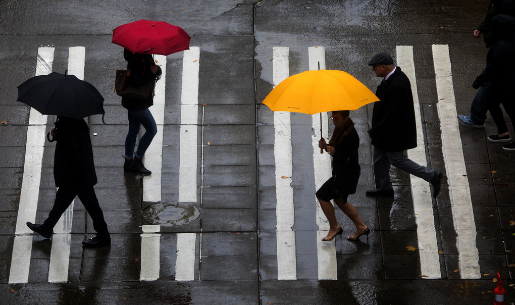 Seattle has completed the wettest four-year stretch in recorded history. Here, pedestrians cross Sixth Avenue at Pine Street in downtown Seattle on October 18, 2017. (Ellen M. Banner/The Seattle Times)