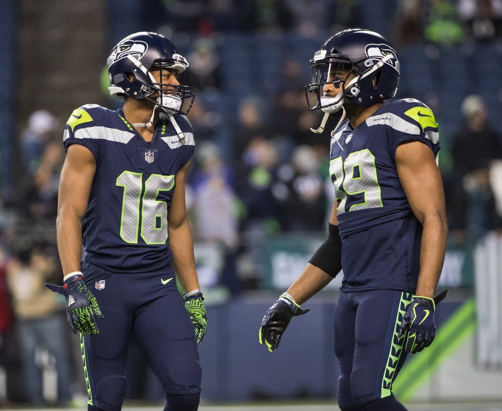 Tyler Lockett, left, and Doug Baldwin warm up catching punts Sunday.    (Dean Rutz / The Seattle Times)