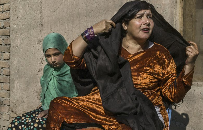 Meena, 11, with her mother Shirin Gul, a covicted serial killer serving a life sentence, at Nangarhar provincial prison, in Jalalabad, Afghanistan, Dec. 2, 2017. Meena was conceived in prison and has never been out, not even for a brief visit. Under Afghan prison policy she can keep her daughter with her until she turns 18. (Mauricio Lima/The New York Times) XNYT5 XNYT5