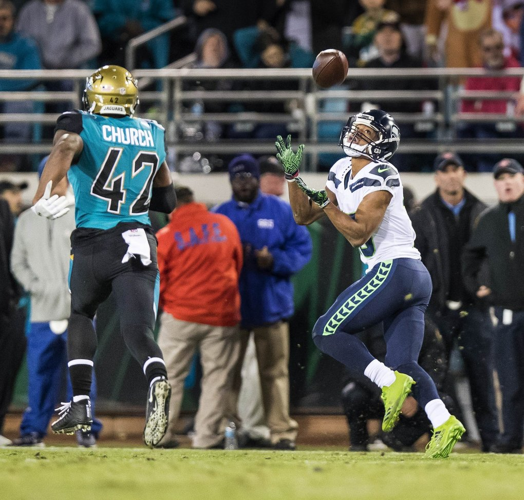 Tyler Lockett has Barry Church beat, and scores on this 74-yard touchdown in the 4th quarter. (Dean Rutz / The Seattle Times)