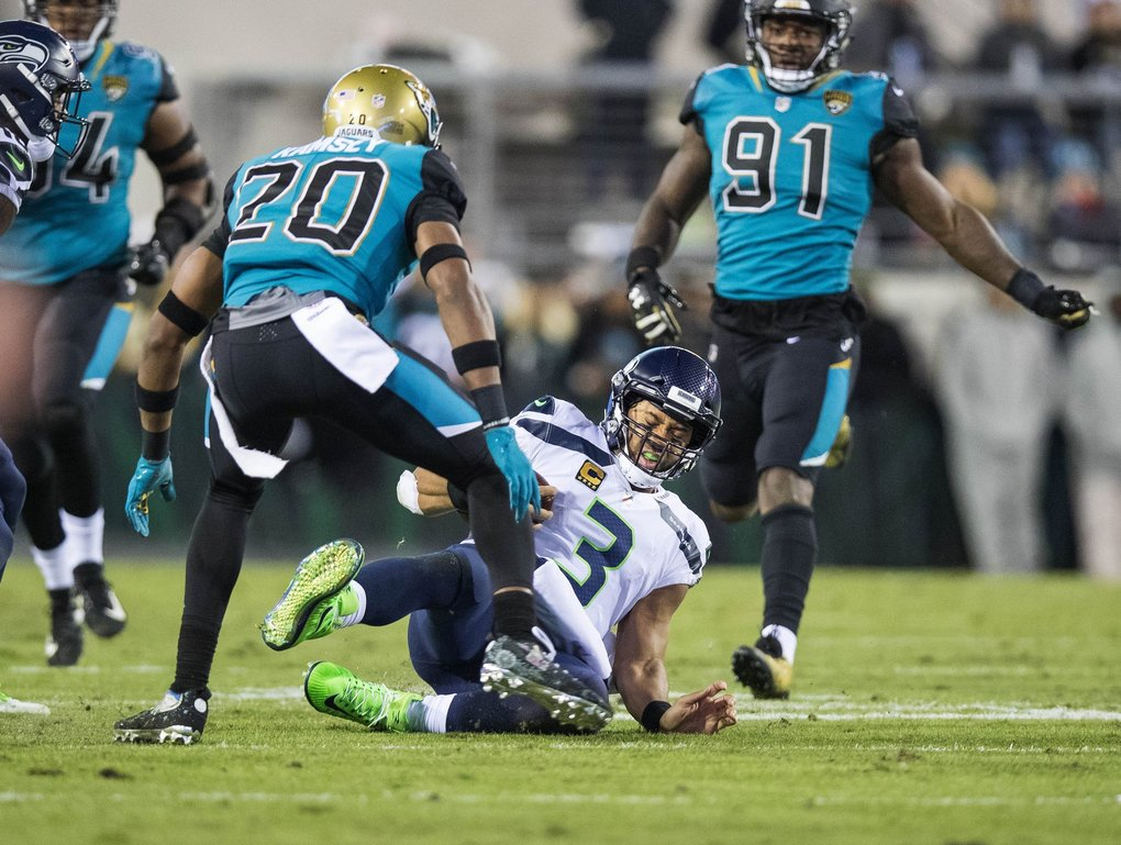 Russell Wilson slides to the 35 and a first down in the 4th quarter. (Dean Rutz / The Seattle Times)