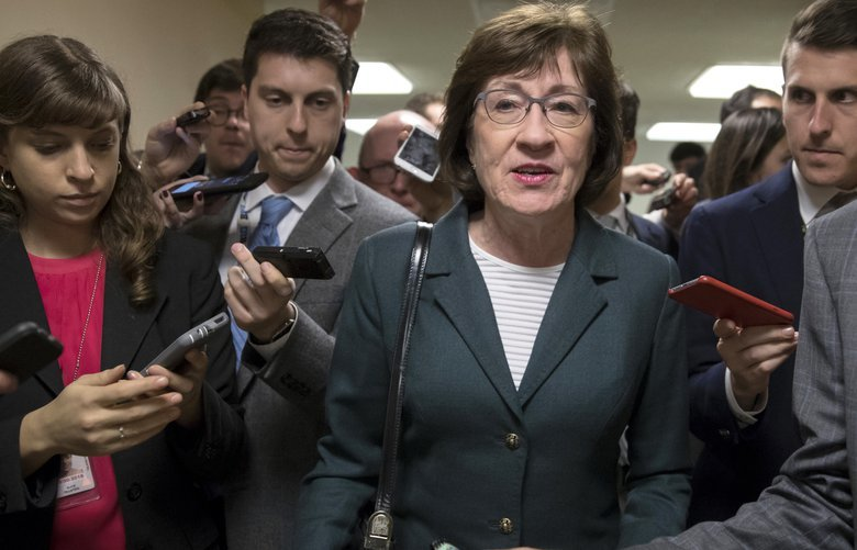 FILE- In this Nov. 30, 2017, file photo, with reporters looking for updates, Sen. Susan Collins, R-Maine, and other senators rush to the chamber to vote on amendments as the Republican leadership works to craft their sweeping tax bill in Washington. Collins said she is confident President Donald Trump and Senate Majority Leader Mitch McConnell will ensure passage of two bills aimed at shoring up the insurance markets, a demand she made before supporting the Republican tax overhaul. (AP Photo/J. Scott Applewhite, File) NYJK505 NYJK505