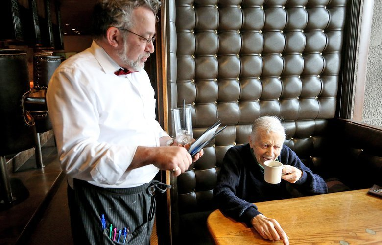 On Monday, December 4, 2017, at the 13 Coins restaurant, long time customer Leonard Speyer, 92, seated, chats with waiter Greg Delaney, left. Speyer was born in Seattle and has been going to the 50-year-old restaurant since it opened in 1967.
