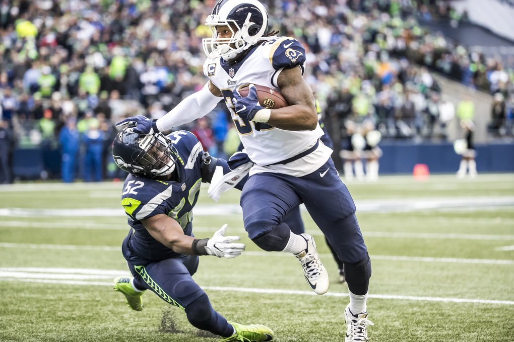 Rams running back Todd Gurley stiff-arms Seahawks outside linebacker Terence Garvin in the second quarter. (Bettina Hansen / The Seattle Times)