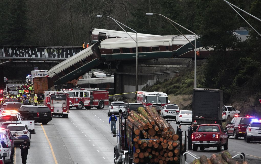 An Amtrak southbound train derailed south of Mounts Road SW overpass onto the I-5 southbound lanes on Monday. (Ellen M. Banner / The Seattle Times)