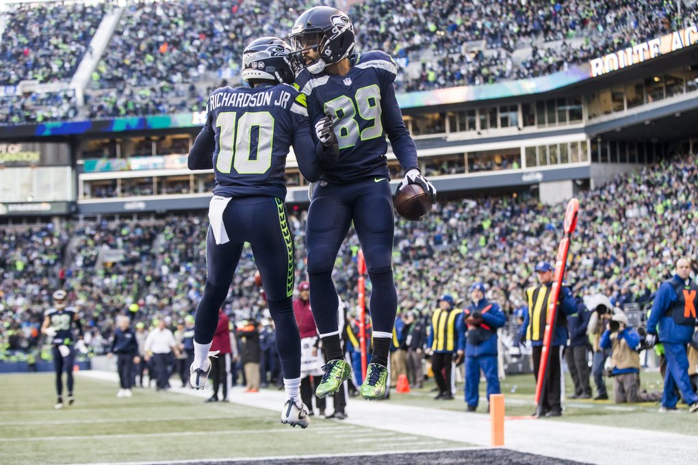 Seahawks wide receiver Doug Baldwin celebrates his 18-yard touchdown in the third quarter of Sunday's game against Arizona with fellow wide receiver Paul Richardson. (Bettina Hansen / The Seattle Times)