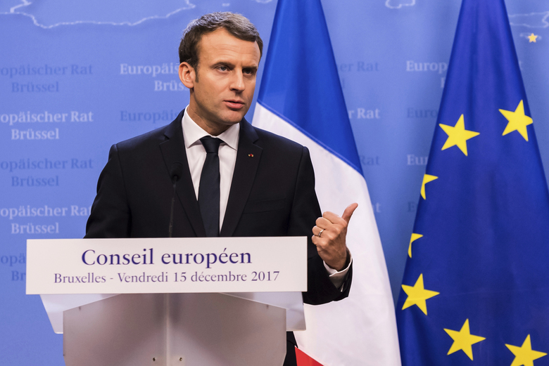 FILE – A Friday, Dec. 15, 2017 file photo of French President Emmanuel Macron addressing a media conference at an EU summit in Brussels. French President Emmanuel Macron thinks the Islamic State group will be defeated in Syria by the middle or end of February and that Syrian President Bashar Assad can't be ignored in the aftermath of a military victory but must one day answer for his crimes, according to a television interview that aired Sunday, Dec. 17, 2017. (AP Photo/Geert Vanden Wijngaert, File)