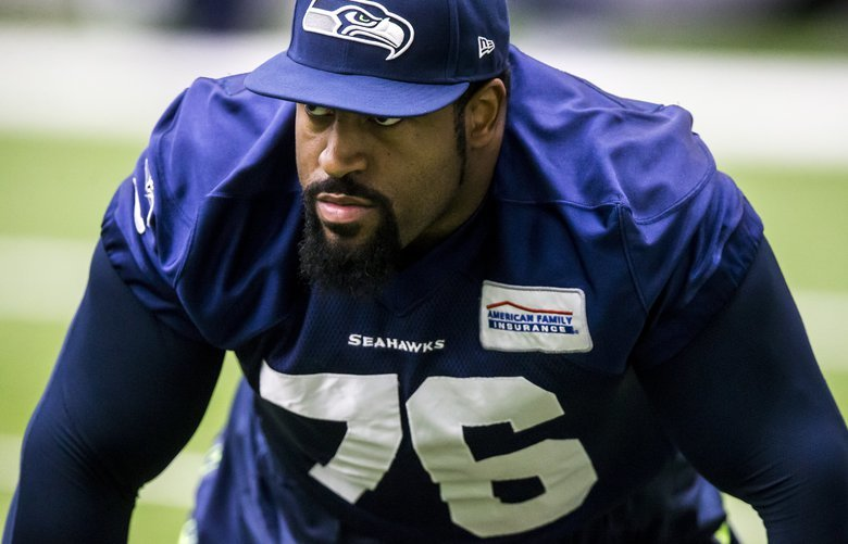 Seahawks offensive tackle Duane Brown stretches during warmups at Seahawks practice at the Virginia Mason Athletic Center in Renton, Tuesday November 14, 2017. 204212