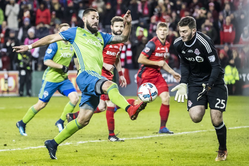 Seattle midfielder Clint Dempsey makes a shot in the final moments, saved by Toronto goalkeeper Alex Bono, as the Seattle Sounders FC take on Toronto FC for the MLS Cup Championship. (Bettina Hansen / The Seattle Times)