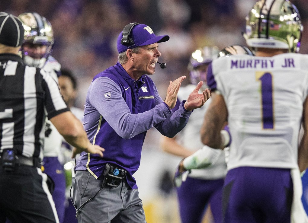 Chris Petersen cheers on his defense after it pulls down an interception in the 2nd half.  (Dean Rutz / The Seattle Times)