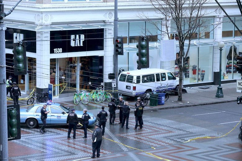 On December 28, 2017, near Fifth Avenue and Pine Street, a Shuttle Express van lost control and ended up on the sidewalk on the east side of Fifth.  (Greg Gilbert / The Seattle Times)