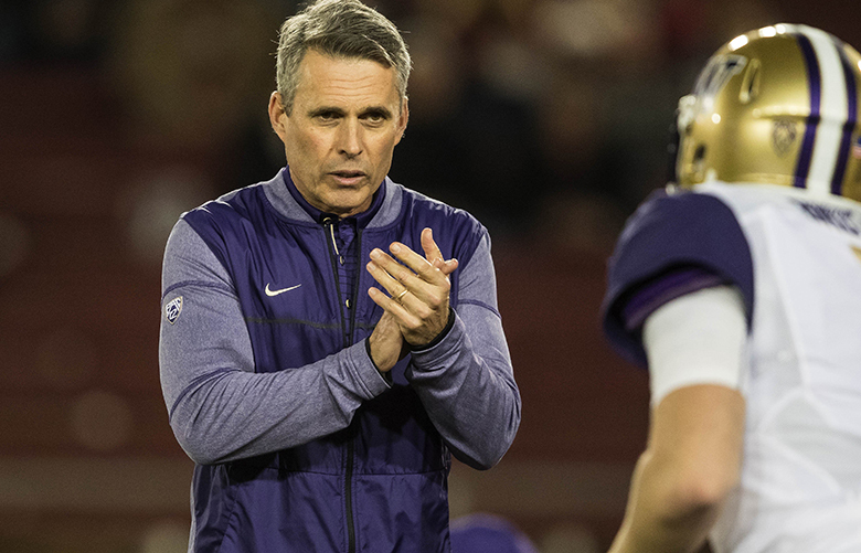 Chris Petersen pumps up quarterback Jake Browning before the start of Friday's game at Stanford.  The Washington Huskies played Stanford Friday, November 10, 2017 at Stanford Stadium in Palo Alto, CA.