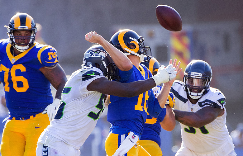 Seattle Seahawks defensive end Frank Clark (55) causes Los Angeles Rams quarterback Jared Goff (16) to fumble during 4th quarter action. The fumble was picked up by Seattle Seahawks defensive tackle Sheldon Richardson (91) as the Los Angeles Rams play the Seattle Seahawks at the Los Angeles Memorial Coliseum on October 8, 2017.  203778