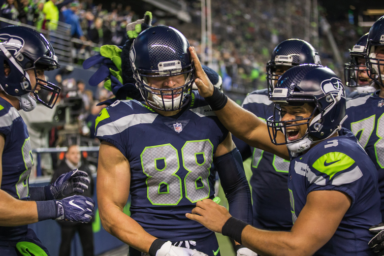 Russell Wilson (3) congratulates Jimmy Graham (88) on a 16-yard touchdown catch in the first quarter of a win over the Eagles on Dec. 3. It was one of three touchdown passes that Wilson threw in another MVP-like performance for the quarterback. (Dean Rutz/The Seattle Times)