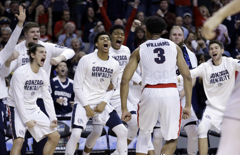 Gonzaga forward Johnathan Williams (3) celebrates with teammates after dunking against Xavier during the second half of an NCAA Tournament college basketball regional final game Saturday, March 25, 2017, in San Jose, Calif. (AP Photo/Ben Margot)  (Ben Margot/AP)