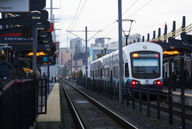 A northbound train heads out from the Sodo light-rail station in November last year. (Lindsey Wasson/The Seattle Times)