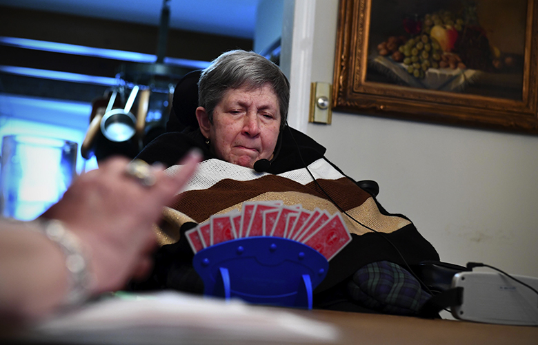 Fridkin contemplates her cards during a game of bridge at her home. MUST CREDIT: Washington Post photo by Katherine Frey.