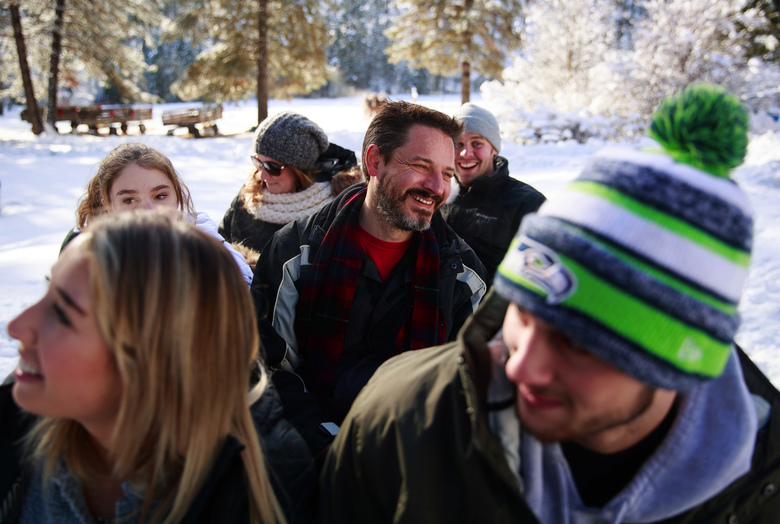 Todd Friesen, of Gig Harbor, center, laughs during a sleigh ride.  (Erika Schultz / The Seattle Times)
