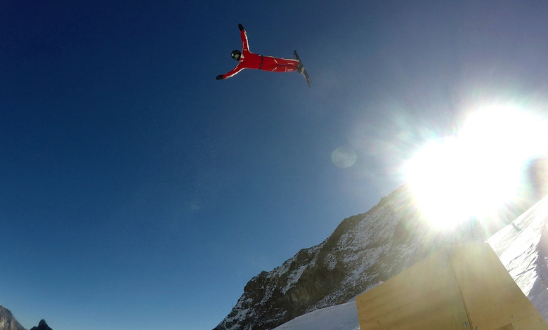 This photo taken from a 4K video and dated Tuesday, Oct. 17, 2017 shows Swiss aerial skier Mischa Gasser as he performs a jump during training on the glacier above Saas-Fee, Switzerland. The glacier attracted skiers and snowboard athletes from an array of nations, who came hunting for snow on which to train early in the season ahead of the 2018 Pyeongchang Olympics. (AP Photo/John Leicester)
