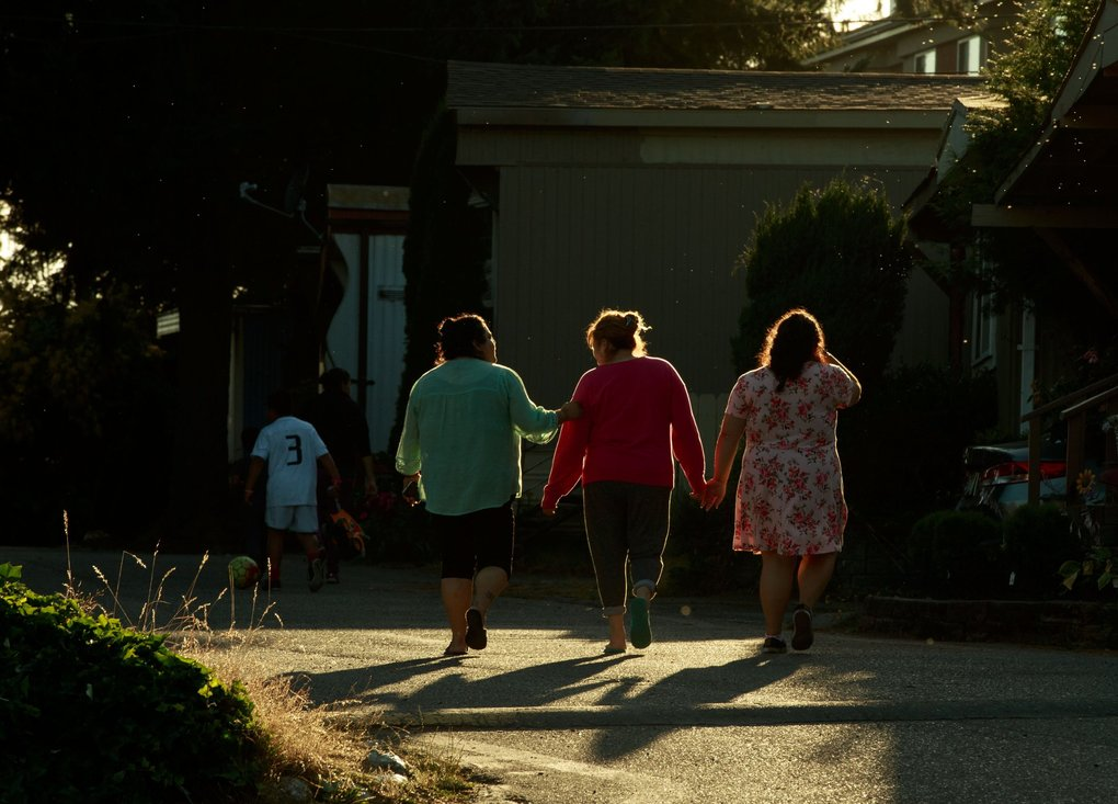 Neighbors leave a meeting at the Firs. Many families say their rent will double or triple if they have to leave, and that this form of affordable housing has allowed families to save and support their children or elderly parents. (Erika Schultz / The Seattle Times)